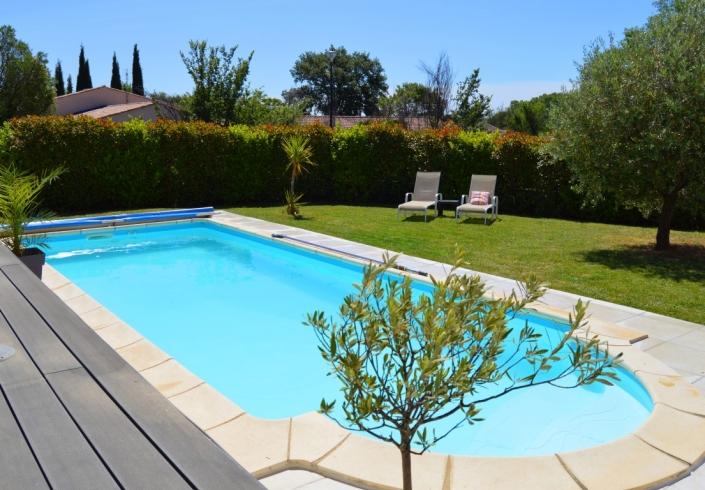 Zwembad en tuin - Le Fil Rouge